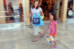 Eight-year-old Olivia Keator and her mother, Julie, enjoy a day of back-to-school shopping at the Connectuct Post mall in Milford.
