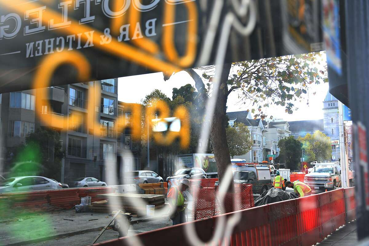 Construction work on Van Ness Avenue is reflected in a window at Bootleg Bar and Kitchen on Thursday, October 4, 2018 in San Francisco, Calif.