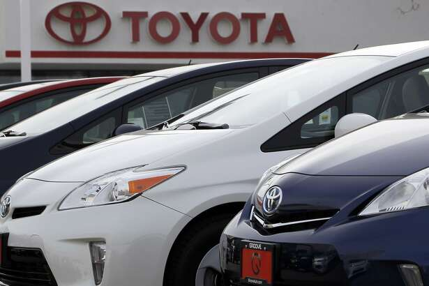 FIEL - This Feb. 19, 2012, file photo shows a line of 2012 Prius sedans at a Toyota dealership in the south Denver suburb of Littleton, Colo. Toyota Motor Corp. said Friday, Oct. 5, 2018, it has issued a recall for 2.43 million hybrid vehicles in Japan and elsewhere for problems with stalling. (AP Photo/David Zalubowski, File)