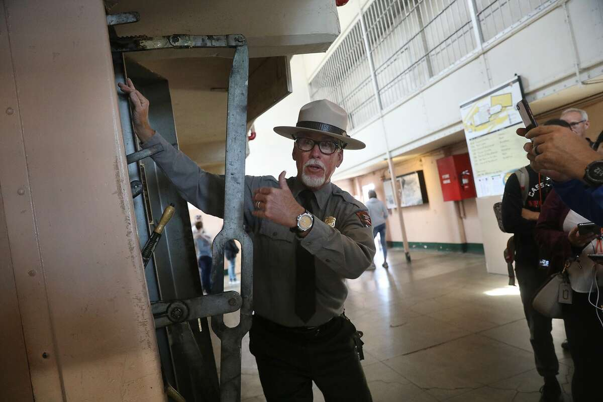 Ranger John Cantwell unlocks the door to a cell at Alcatraz. Among his accomplishments, he talked a private prison company into repairing all the locks in the main cellblock.