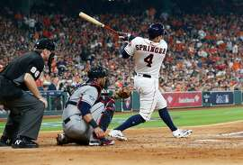 Houston Astros outfielder George Springer (4) hits a home run in the fourth inning of Game 1 of the American League Division Series at Minute Maid Park on Friday, Oct. 5, 2018, in Houston.