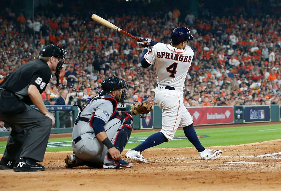 Houston's George Springer hits a home run in the fourth inning of Game 1 of the ALDS series against Cleveland. Photo: Brett Coomer / Staff Phototgrapher