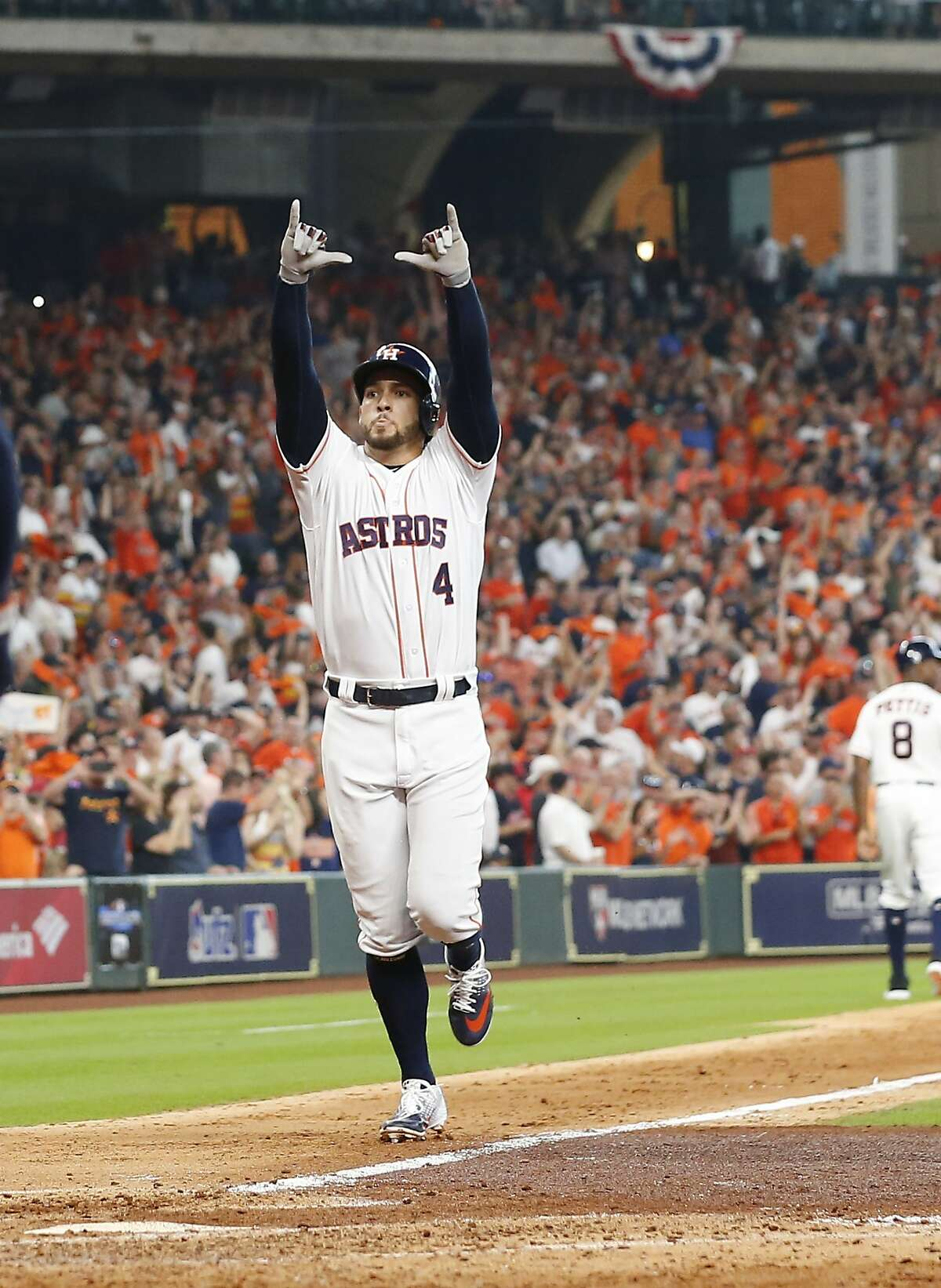 Houston Astros outfielder George Springer (4) celebrates a fifth inning home run in Game 1 of the American League Division Series at Minute Maid Park on Friday, Oct. 5, 2018, in Houston.
