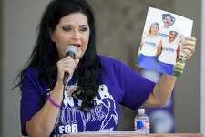 Debra Miller talks at the domestic violence awareness event Tuesday in front of the courthouse. Jacy Lewis/191 News