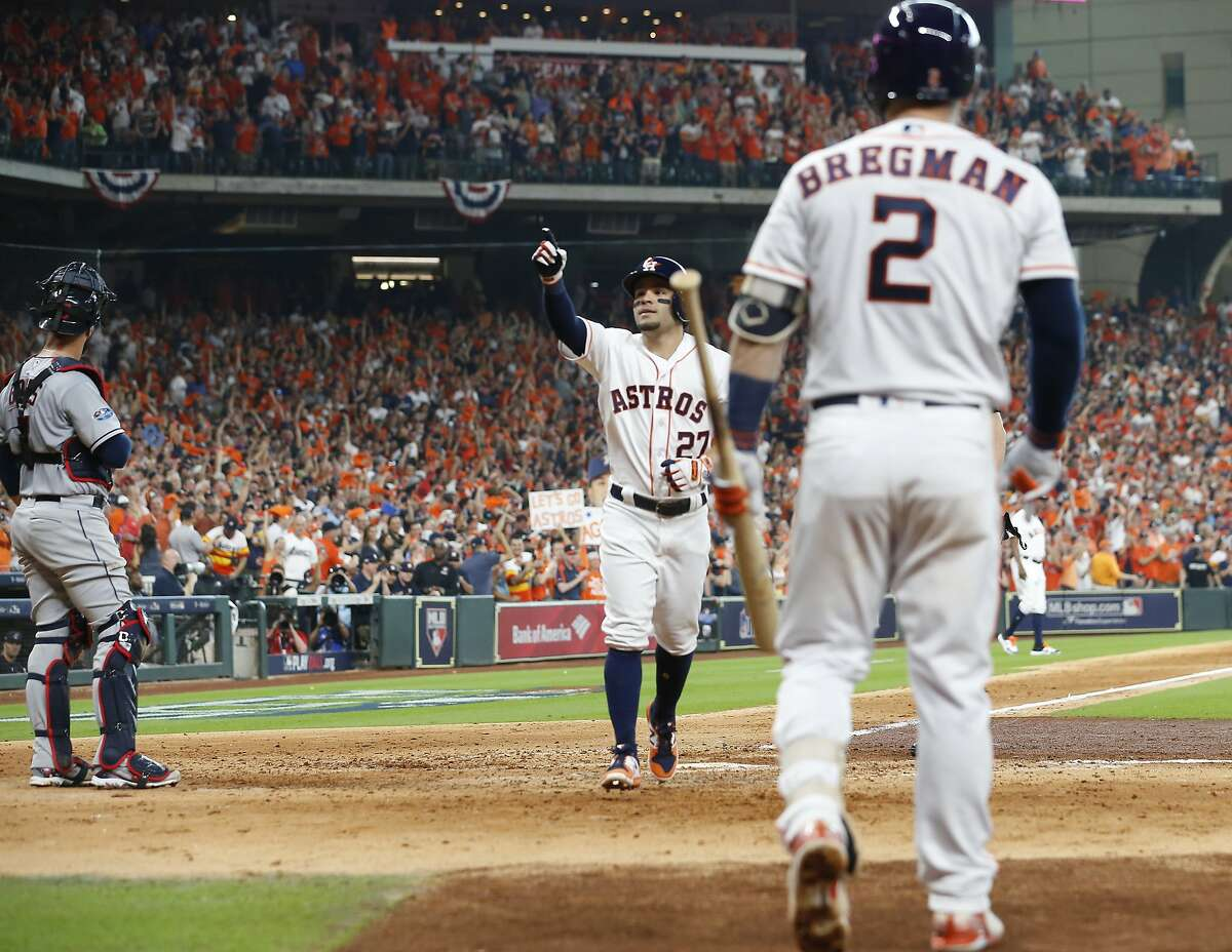 Houston Astros second baseman Jose Altuve (27) celebrates a home run in the fifth inning of Game 1 of the American League Division Series at Minute Maid Park on Friday, Oct. 5, 2018, in Houston.