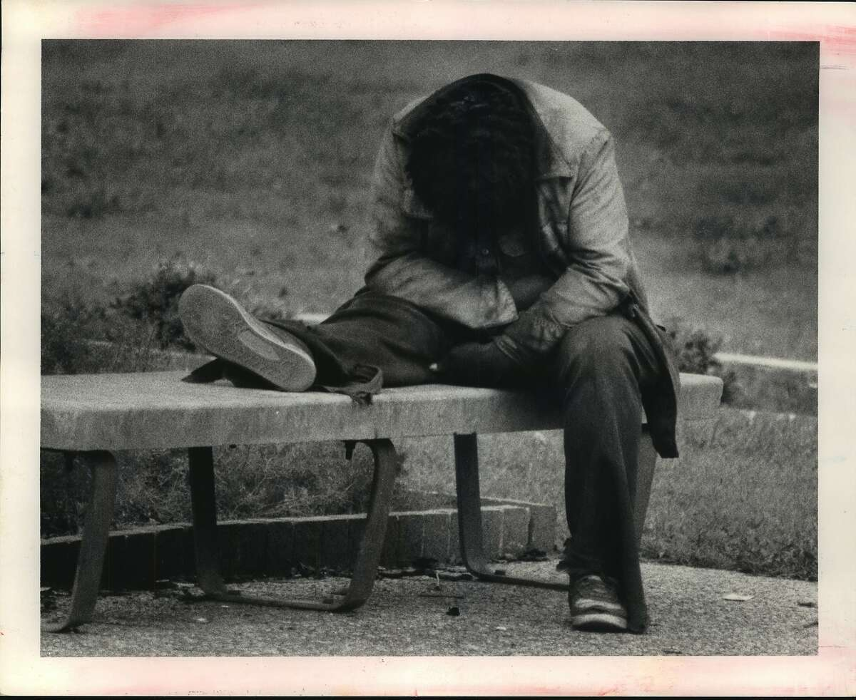 """This is """"George"""" who is the stay on the street people. He is napping downtown which he inhabits. He says he was once hospitalized for schizophrenia but now lives on the street. Homeless People - Houston, Texas. """"George,"""" a former mental patient, dozes on a park bench in downtown Houston, Texas. He is one of many mentally ill people whom area mental health faculties are unable to help and who have nowhere to go."""