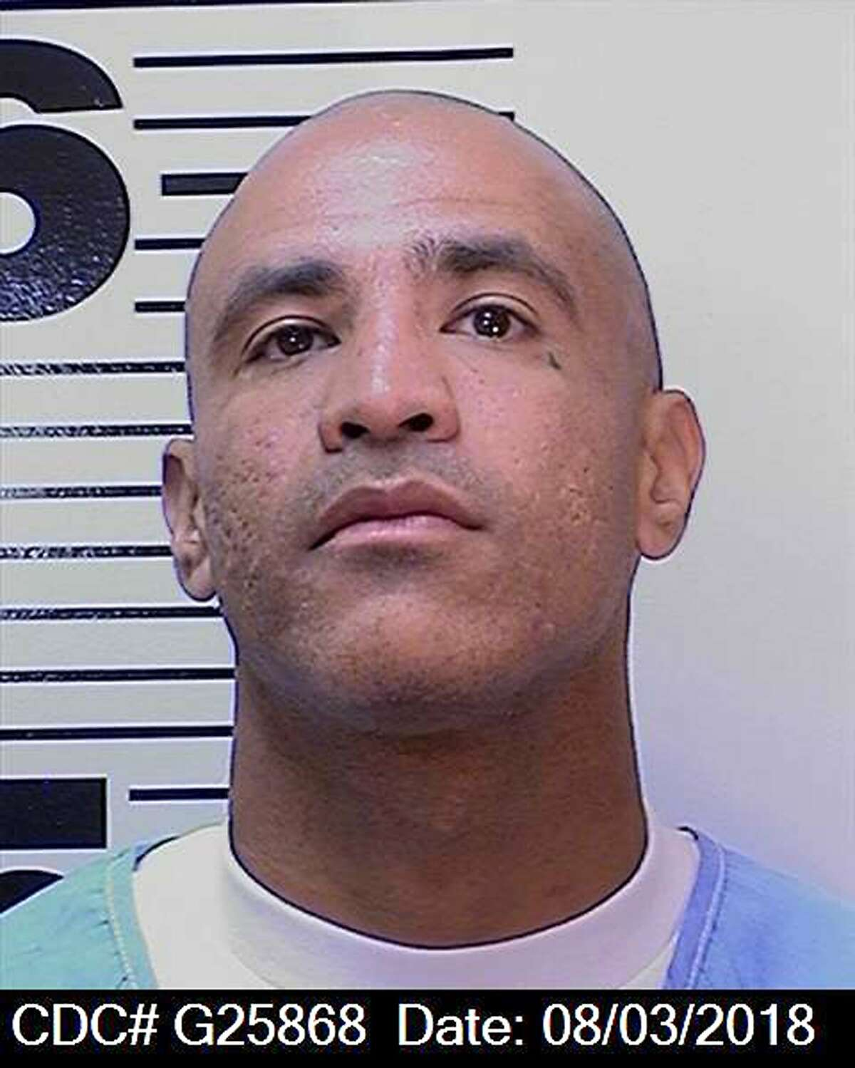 This Aug. 3, 2018 photo provided by the California Department of Corrections and Rehabilitation (CDCR) shows death row inmate Luis Rodriguez, 34. Corrections spokeswoman Terry Thornton says Rodriguez is the suspect in the stabbing death of fellow condemned inmate Jonathan Fajardo, 30, who was stabbed to death in the chest and neck with an inmate-made weapon Friday, Oct. 5, 2018, in a recreational yard of the cell house that holds the bulk of condemned inmates at San Quentin State Prison. (California Department of Corrections and Rehabilitation via AP)