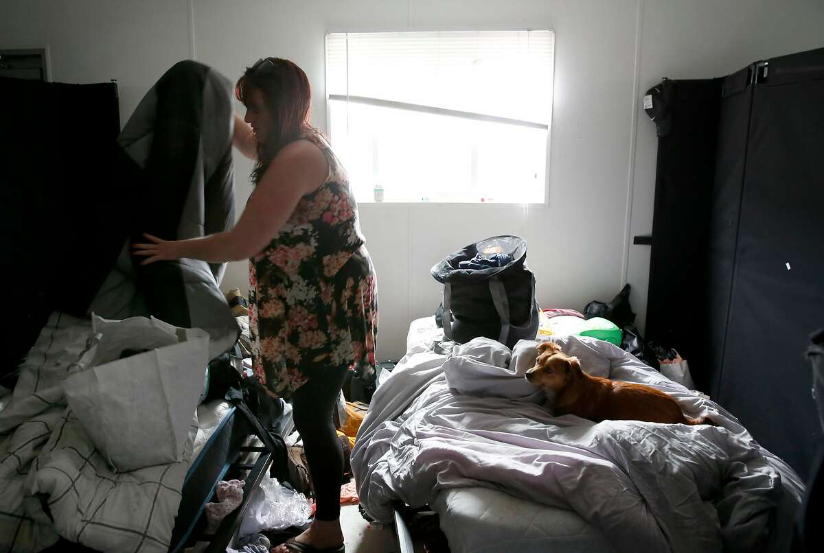 Sarah Smith packs belongings before moving out of the Pathways STAIR Center temporary housing community in Berkeley, Calif. on Wednesday, Oct. 3, 2018. Smith and her boyfriend Zack Minjarez are moving into their own East Oakland studio apartment later in the day.