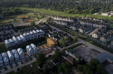 New homes are constructed in the 100-year floodplain along White Oak Bayou in the Shady Acres neighborhood, Friday, Oct. 5, 2018, in Houston.