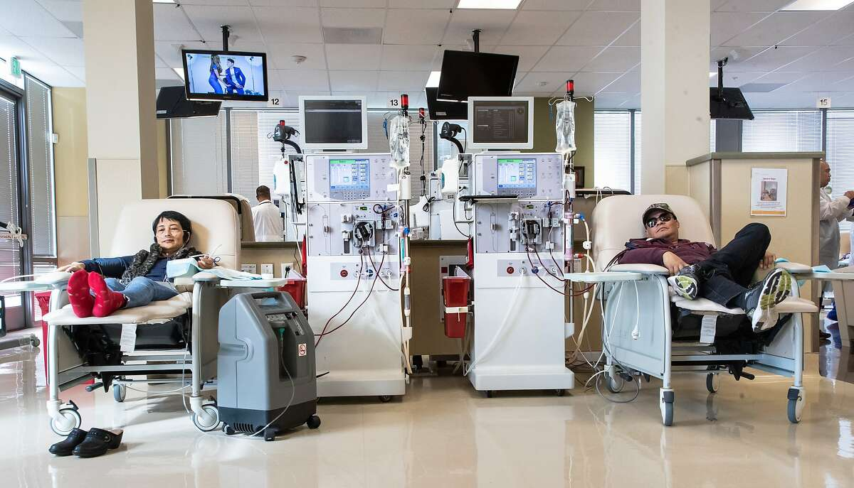 YanLing Li (left) and Jose Villanueva rest during their 3-hour dialysis at the Satellite Dialysis Clinic on Thursday, Oct. 4, 2018, in Daly City, CA.