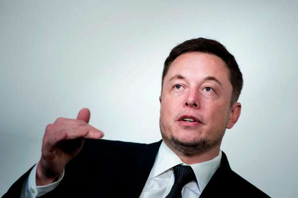 """(FILES) In this file photo taken on July 19, 2017, Elon Musk, CEO of SpaceX and Tesla, speaks during the International Space Station Research and Development Conference at the Omni Shoreham Hotel in Washington, DC. - Less than a week after settling fraud charges with the US Securities and Exchange Commission, Tesla Chief Executive Elon Musk on October 4, 2018 derided the agency on Twitter.""""Just want to that the Shortseller Enrichment Commission is doing incredible work. And the name change is so on point!"""" Musk said on Twitter.The statement by the electric automaker's CEO alludes to """"shortsellers,"""" investors who have bet that Tesla shares will fall and who are frequently the subject of Musk's derision. (Photo by Brendan Smialowski / AFP)BRENDAN SMIALOWSKI/AFP/Getty Images"""