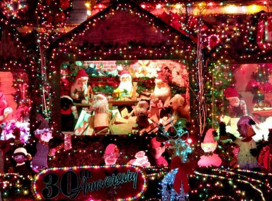 The mega-watt show of Christmas lights at the Merriman house at 285 Main St. has been a regional attraction for nearly 40 years. Photo: File Photo