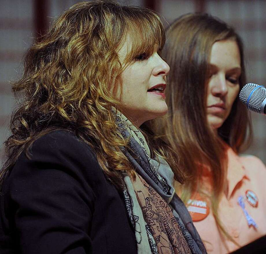 Abbey Clements, left, of Newtown, at the Vigil to End Gun Violence at the Unitarian Church of Westport on Dec. 10, 2017. Photo: / Brian A. Pounds