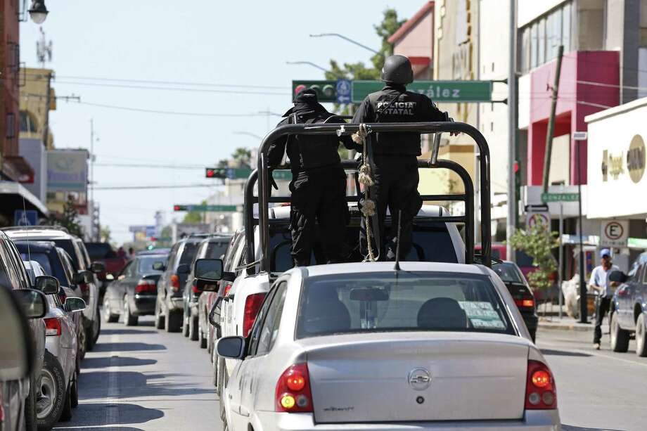 The Tamaulipas State Police patrols the downtown streets of Nuevo Laredo, Mexico, Wednesday, August 25, 2016. A spate of violence has erupted throughout section of Nuevo Laredo as drug cartels fight for control. The Tamaulipas State Police and the Mexican Army are collaborating and patrol the city's streets in an attempt to bring calm to the area. Photo: Jerry Lara /San Antonio Express-News / © 2016 San Antonio Express-News