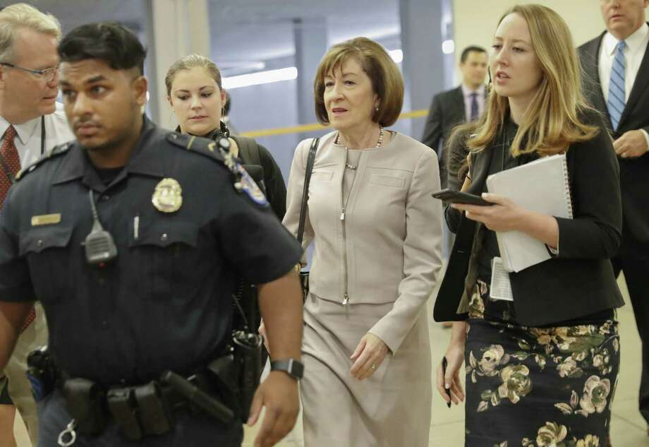 Sen. Susan Collins, R-Maine, is followed by members of the media as she walks to the Capitol before a vote to advance Brett Kavanaugh's nomination to the Supreme Court, on Capitol Hill, Friday, Oct. 5, 2018 in Washington. (AP Photo/Pablo Martinez Monsivais) Photo: Pablo Martínez Monsiváis /Associated Press / Copyright 2018 The Associated Press. All rights reserved