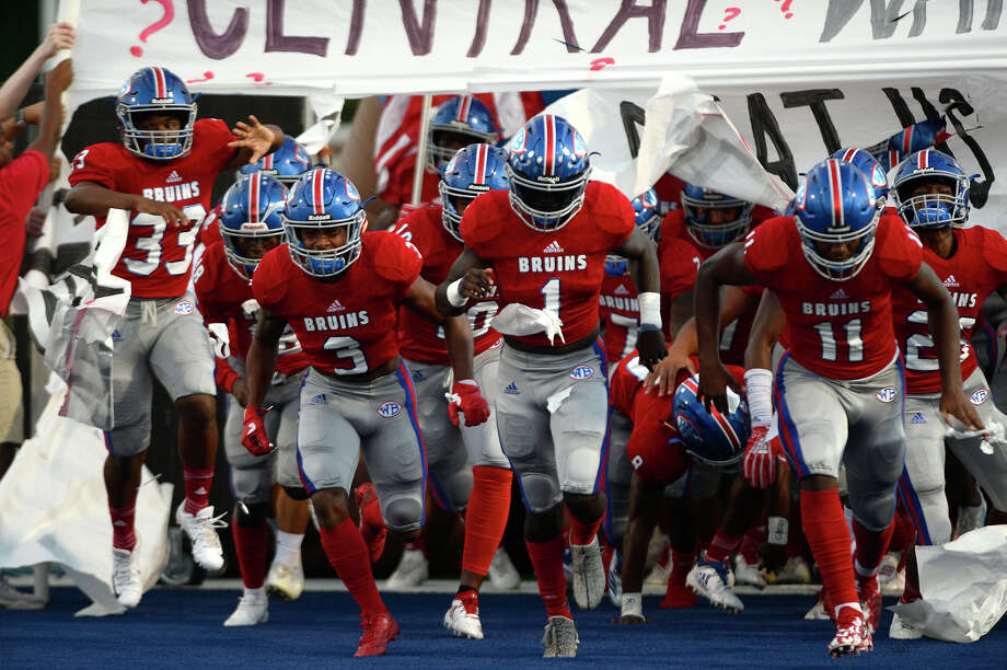 "West Brook players run onto the field before the ""Alumni Bowl"" between Beaumont United and West Brook at the Beaumont ISD Memorial Stadium on Friday night. 