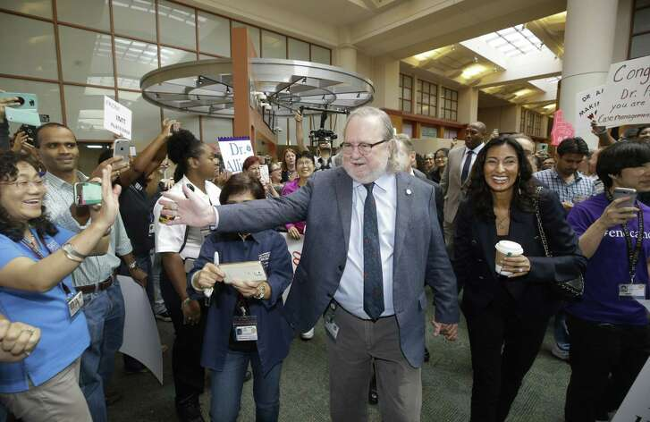 Jim Allison and his wife, Pam Sharma, walk through a procession at MD Anderson Cancer Center Friday, Oct. 5, 2018, in Houston as part of a celebration of his receiving the Nobel Prize earlier this week.