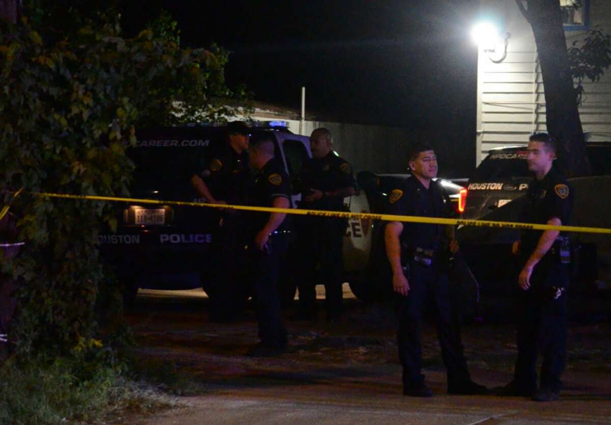 Houston police officers investigate a drive-by shooting where a 12-year-old girl was shot in northwest Houston on Friday, Oct. 5, 2018.