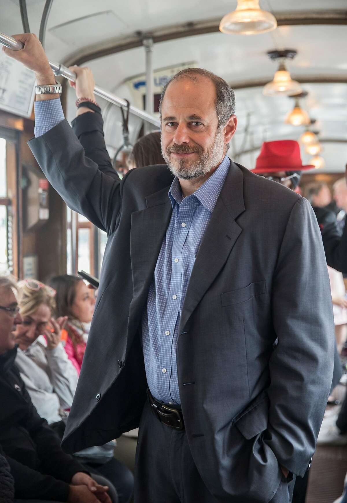 SFMTA Transit Chief Ed Reiskin poses for a portrait while riding a streetcar up Market Street from the SFMTA headquarters in San Francisco, Calif. Thursday, Aug. 23, 2018.