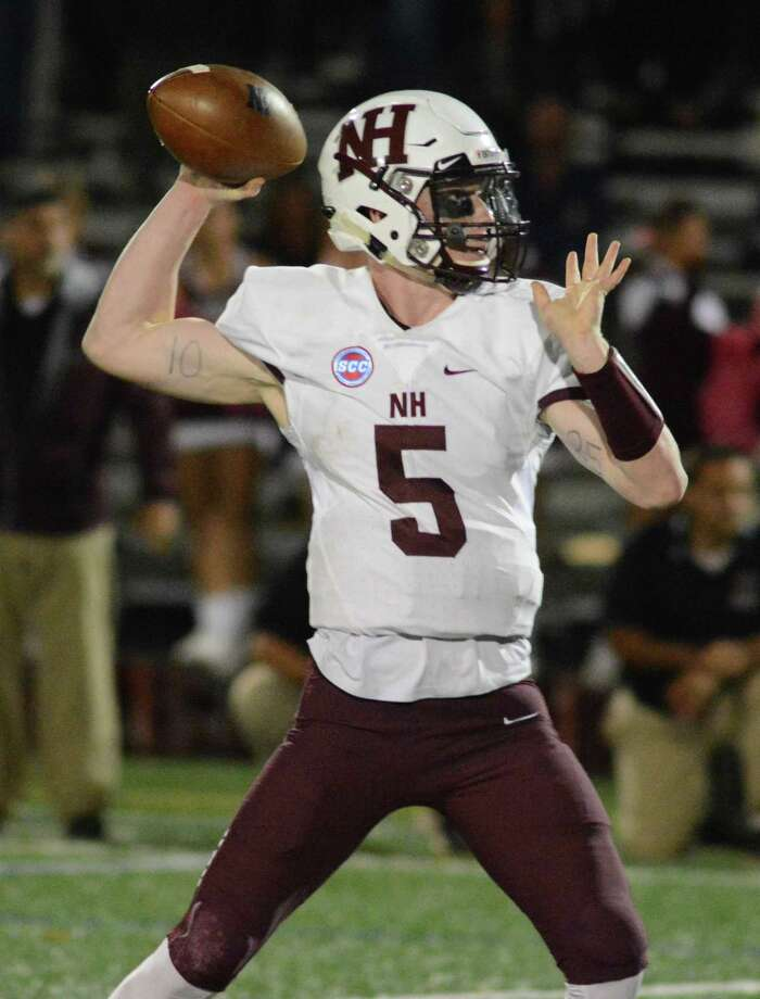 North Haven quarterback Shamus Meehan delivers a pass during Friday's game against Hillhouse. Photo: Dave Phillips / For Hearst Connecticut Media
