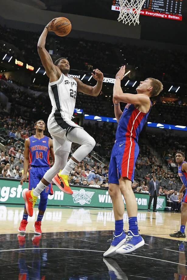 Rudy Gay #22 of the San Antonio Spurs go for a dunk against Henry Ellenson #8 of the Detroit Pistons Detroit Pistons v San Antonio Spurs at the AT&T Center on Friday, October 5, 2018. Photo: Ronald Cortes/Correspondent