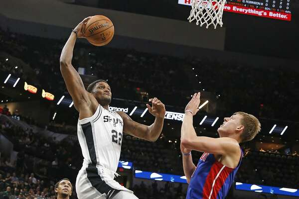 Rudy Gay #22 of the San Antonio Spurs go for a dunk against Henry Ellenson #8 of the Detroit Pistons Detroit Pistons v San Antonio Spurs at the AT&T Center on Friday, October 5, 2018.