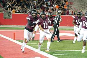 \Pearland's Devin Linton (6) and Pearland's Johnny Tamayo (11) celebrate after scoring a touchdown following a fumble recovery by Tamayo against Dawson Friday, Oct. 5 at the University of Houston.