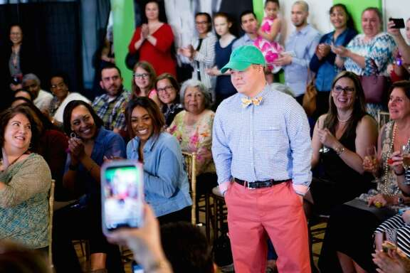 Down Syndrome Academy student Adrian Vasquez walks the runway in the 2017 fashion show.