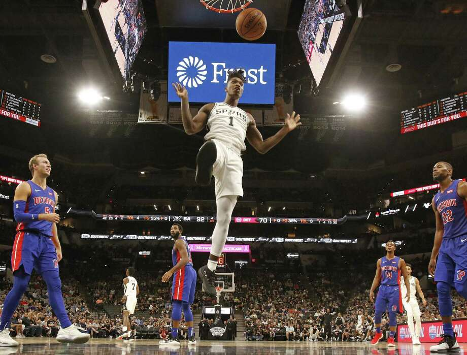 Lonnie Walker #1 of the San Antonio Spurs dunks against the Pistons. Detroit Pistons v San Antonio Spurs at the AT&T Center on Friday, October 5, 2018. Photo: Ronald Cortes/Correspondent / 2018 Ronald Cortes