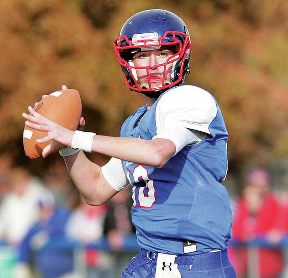 Carlinville QB Jarret Easterday completed 21 of 26 passes for 275 yards and three touchdowns in the Cavies' 64-28 victory Friday night at Vandalia. The senior surpassed 5,000 yards passing in his career at Carlinville. Photo: Telegraph Photo