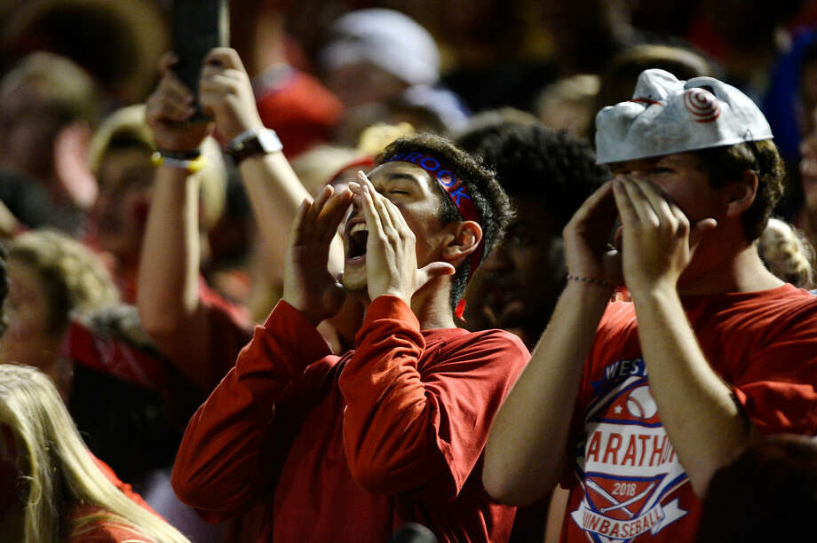 "West Brook fans cheer during the ""Alumni Bowl"" between Beaumont United and West Brook at the Beaumont ISD Memorial Stadium on Friday night. 