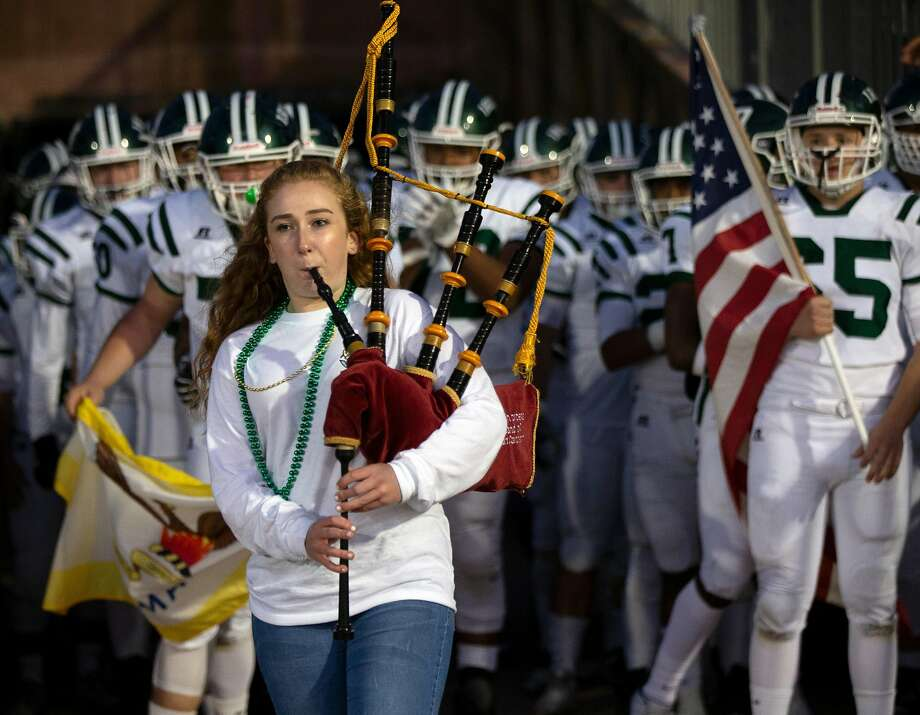 Freshman Maura Baglin leads the Sacred Heart Cathedral football team onto the field with a bagpipe solo before a game against St. Ignatius in San Francisco on Oct. 5. Photo: D. Ross Cameron / Special To The Chronicle