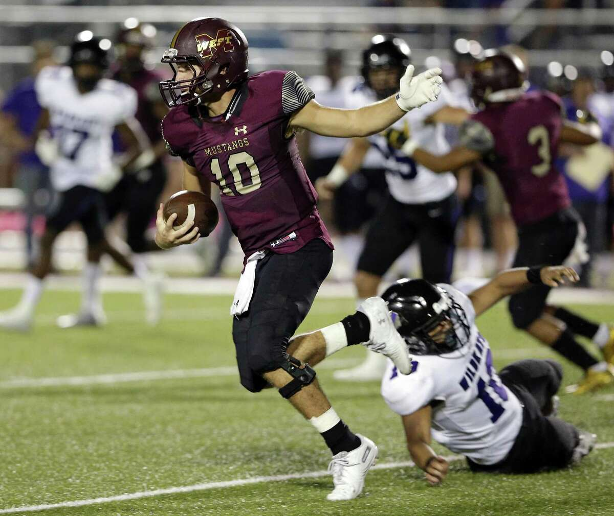 Magnolia West's John Matocha slips the tackle attempt by Willis' Jesus Villeda (10) during the first half of their game at Magnolia West Friday in Magnolia.