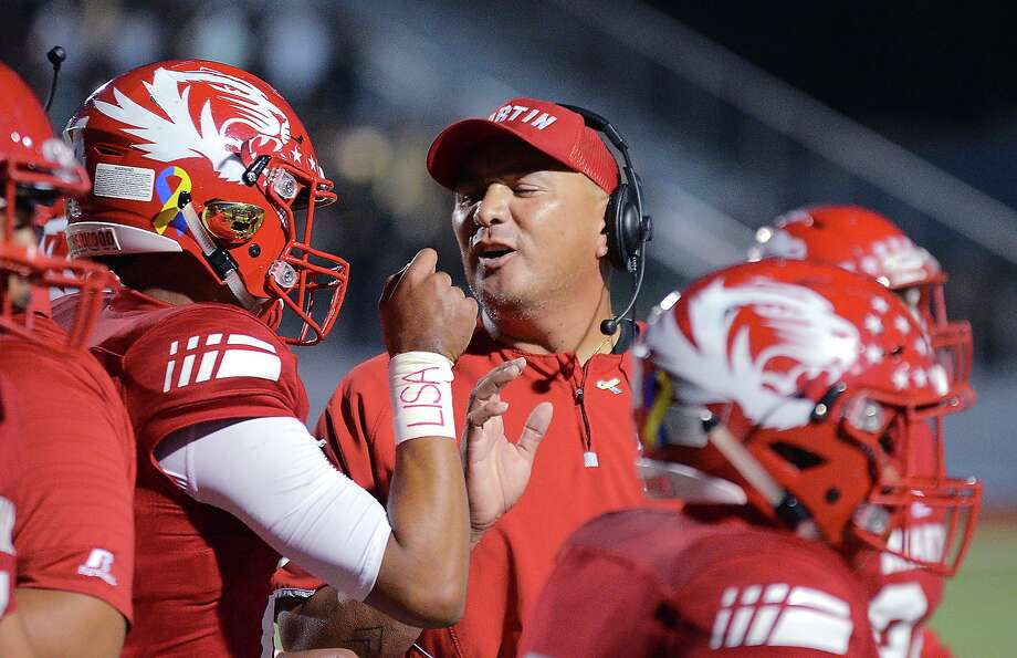 Tigers' head football coach, David Charles and his starting quarterback Matthew Duron have a word after Duron scored in their game against San Antonio Southwest Legacy Friday, October 5, 2018 at Shirley Field. Photo: Cuate Santos / Laredo Morning Times File / Laredo Morning Times