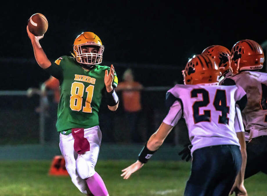 Southwestern quarterback Trevor Smith (81) scrambles while looking for an open receiver Friday night in the Piasa Birds' 37-6 Homecoming loss to Pana.
