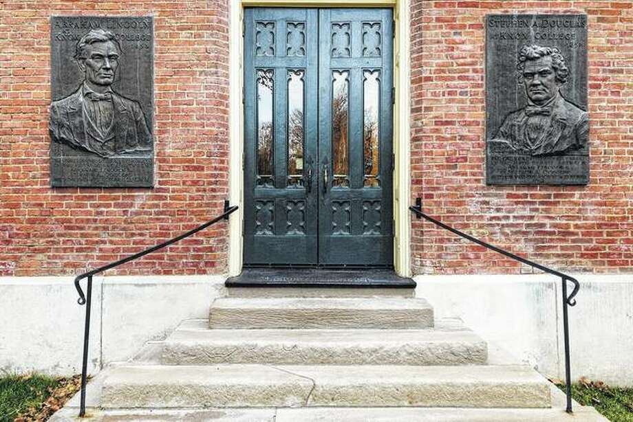 Tablets of Abraham Lincoln and Stephen Douglas adorn the east entrance of Old Main on the Knox College campus in Galesburg. The tablets were hung during a celebration honoring the 100th anniversary of the Oct. 7, 1858, debate in Galesburg. Photo: Steve Davis | Register-Mail