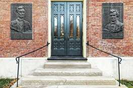 Tablets of Abraham Lincoln and Stephen Douglas adorn the east entrance of Old Main on the Knox College campus in Galesburg. The tablets were hung during a celebration honoring the 100th anniversary of the Oct. 7, 1858, debate in Galesburg.