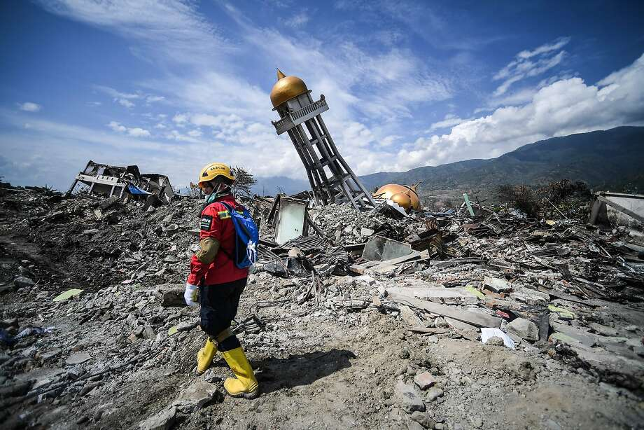 A member of a search and rescue team examines debris near a collapsed mosque in the Balaroa neighborhood of Palu, Indonesia. The area was ravaged by the 7.5-magnitude quake on Sept. 28. Photo: Mohd Rasfan / AFP / Getty Images