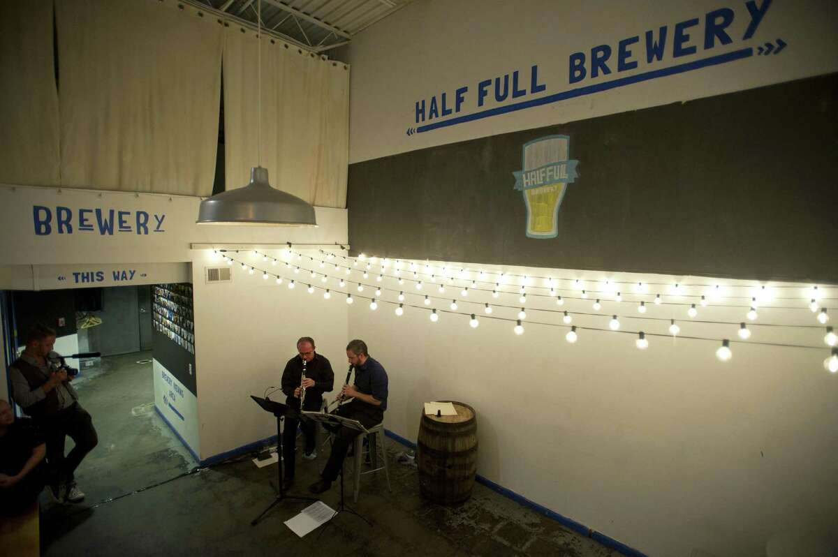 Pavel Vinnitsky (center left) and Jonathan Cohen, clarinetists in the Stamford Symphony Orchestra, play inside Half Full Brewery during Symphony on Tap in Stamford, Conn. on Wednesday, Oct. 4, 2018. Symphony on Tap is an initiative to bring the music to those unfamiliar, especially people under the age of 40, to the symphony.