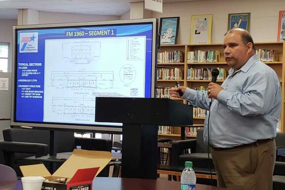Entech Civil Engineers Chief Information Officer Chris Orosco explains the process of the FM 1960 widening project on Oct. 4, 2018 at the Humble Biz Com in Humble High School.