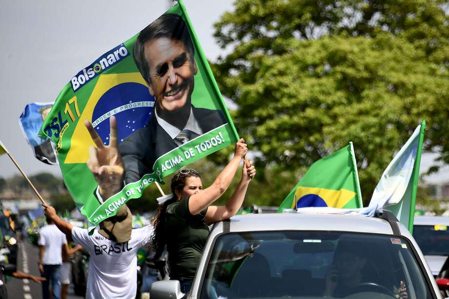 Supporters of Brazils far-right presidential candidate Jair Bolsonaro take part in a campaign rally in Brasilia, on October 6, 2018. (Photo by EVARISTO SA / AFP)EVARISTO SA/AFP/Getty Images Photo: EVARISTO SA;Evaristo Sa / AFP / Getty Images