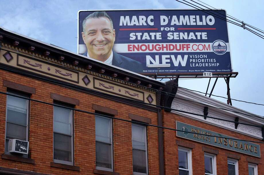 Campaign signs for the Republican candidate Marc D'Amelo in the race for the 25th District State Senate seat Thursday, October 4, 2018, at Liberty Square in Norwalk, Conn. Photo: Erik Trautmann / Hearst Connecticut Media / Norwalk Hour