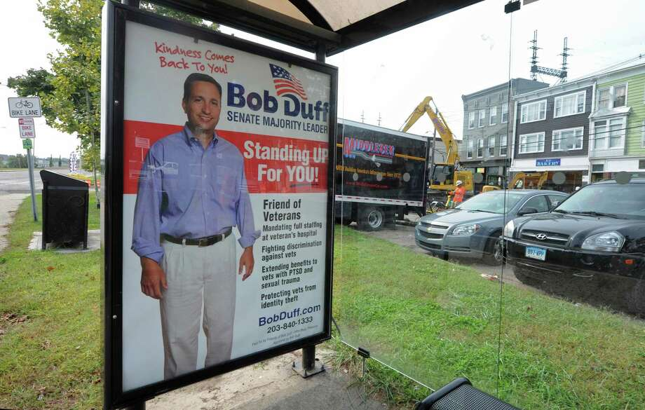 Campaign signs for the State Senate Majority Leader Bob Duff in 25th District state senate race Thursday, October 4, 2018, at Liberty Square in Norwalk, Conn. Photo: Erik Trautmann / Hearst Connecticut Media / Norwalk Hour