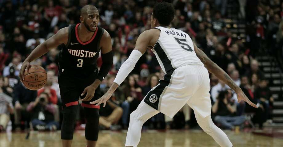 HOUSTON, TX - DECEMBER 15:  Chris Paul #3 of the Houston Rockets looks to move on Dejounte Murray #5 of the San Antonio Spurs at Toyota Center on December 15, 2017 in Houston, Texas. NOTE TO USER: User expressly acknowledges and agrees that, by downloading and or using this photograph, User is consenting to the terms and conditions of the Getty Images License Agreement.  (Photo by Bob Levey/Getty Images) Photo: Bob Levey/Getty Images