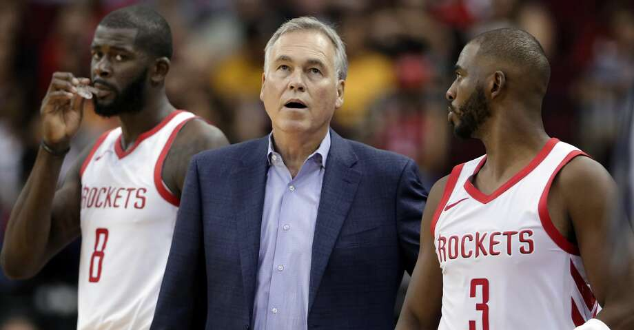 Houston Rockets coach Mike D'Antoni checks the scoreboard as he stands between players James Ennis III (8) and Chris Paul (3) during the second half of the team's NBA basketball preseason game against the Indiana Pacers on Thursday, Oct. 4, 2018, in Houston. (AP Photo/Michael Wyke) Photo: Michael Wyke/Associated Press