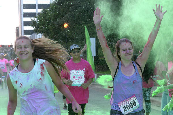 Participants celebrate as they make their way through the coplor stations during the annual Gift of Life Julie Richardson Procter 5K Ribbon Run Color Rush in Beaumont. Saturday, October 6, 2018 Kim Brent/The Enterprise