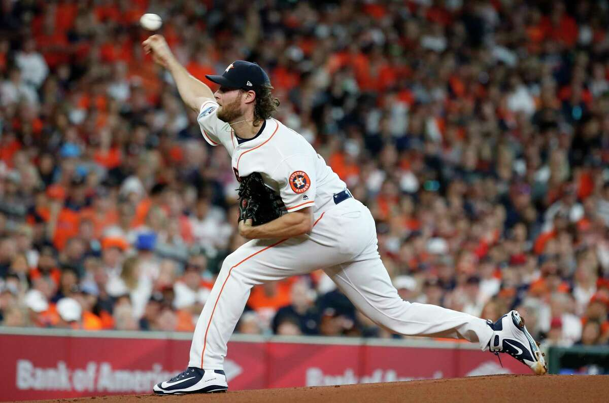 Houston Astros pitcher Gerrit Cole (45) throws a pitch in the first inning of Game 2 of the American League Division Series at Minute Maid Park on Saturday, Oct. 6, 2018, in Houston.