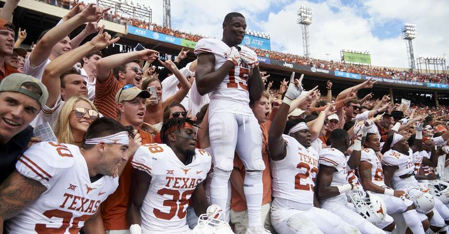 Texas players celebrates after defeating Oklahoma 48-45 in an NCAA college football game at the Cotton Bowl, Saturday, Oct. 6, 2018, in Dallas. (AP Photo/Cooper Neill) Photo: Cooper Neill/Associated Press