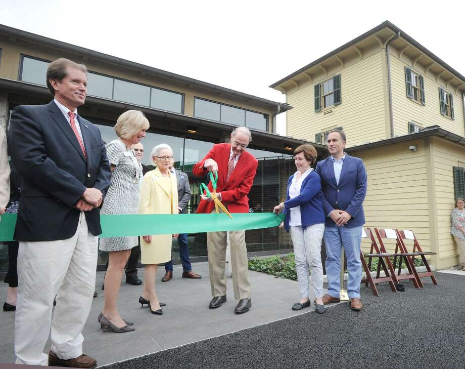 At center, Peter Malkin, chairman of the Reimagined Campus Capital Campaign, cut the ribbon during the opening day party celebrating the new campus of the Greenwich Historical Society in the Cos Cob section of Greenwich, Conn., Saturday, Oct. 6, 2018. Other dignitaries from left to right, State Senator L. Scott Frantz, Debra Mecky executive director & ceo of the Greenwich Historical Society, Davidde Strackbein, chairman of the board of trustees of the society, State Representative Livvy Floren and Greenwich First Selectman Peter Tesei. The society's new campus was officially opened to the public after the ceremony that was led by Strackbein. The new campus includes a new library and archives, a Gallery for Special Exhibitions, a Gallery for Permanent Collections, a new museum lobby and museum store and an artist's cafe. There is also a new extensive parking lot adjacent to the campus. Photo: Bob Luckey Jr. / Hearst Connecticut Media / Greenwich Time