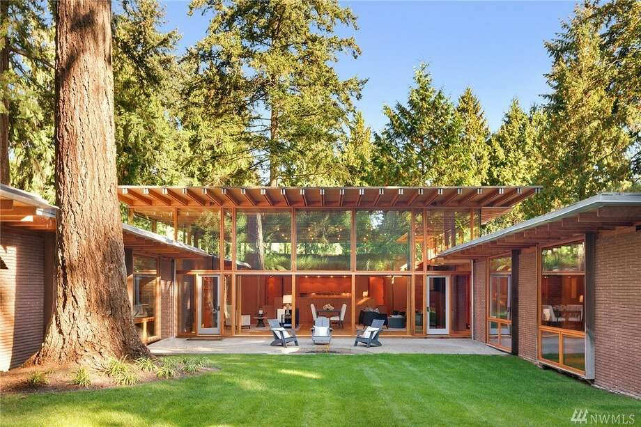 This beautiful custom home was built by the same architect that designed Bill Gates' home, for sale now in Beaux Arts Village for $5.388M Photo: Clarity Northwest Via Mary Norris/Sotheby's